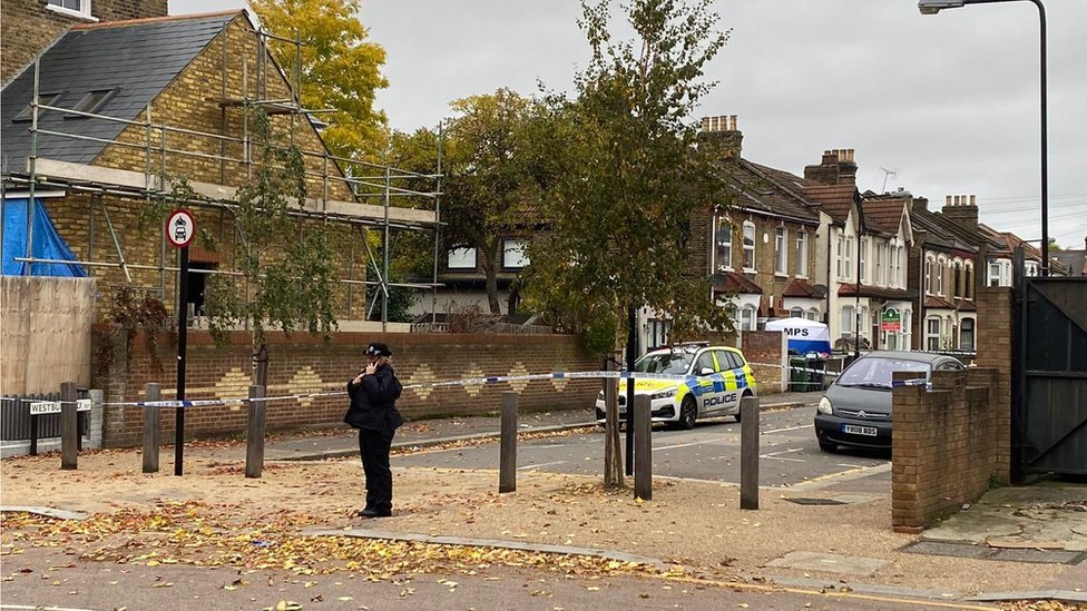 Police officer stands by the crime scene on Westbury Road