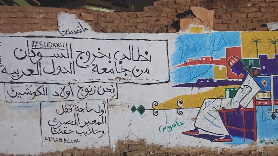 """A mural with the words: """"We demand that Sudan leaves the Arab League. We are black people, the sons of Kushites and the return of the Hala'ib Triangle"""" - Khartoum, Sudan"""