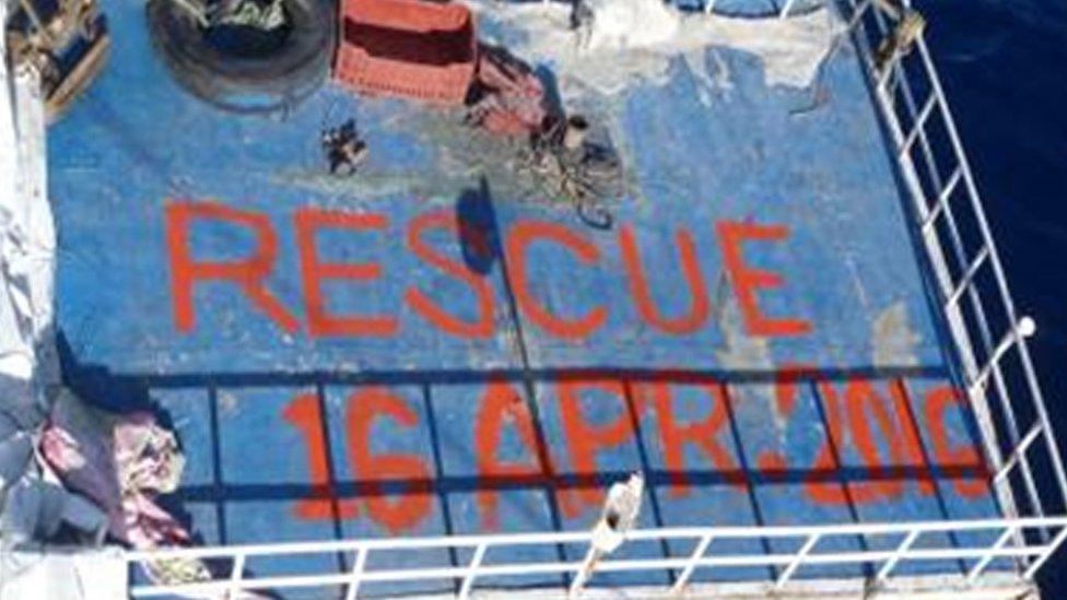 """""""Rescue 16 April"""" is written on the top of a cargo ship"""