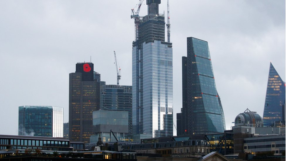 A commemorative poppy can be seen atop Tower 42 in the city of London,
