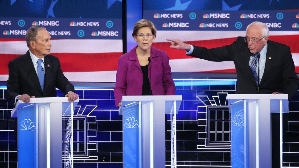 Mike Bloomberg, left, Elizabeth Warren, middle, and Bernie Sanders, right, on the debate stage.