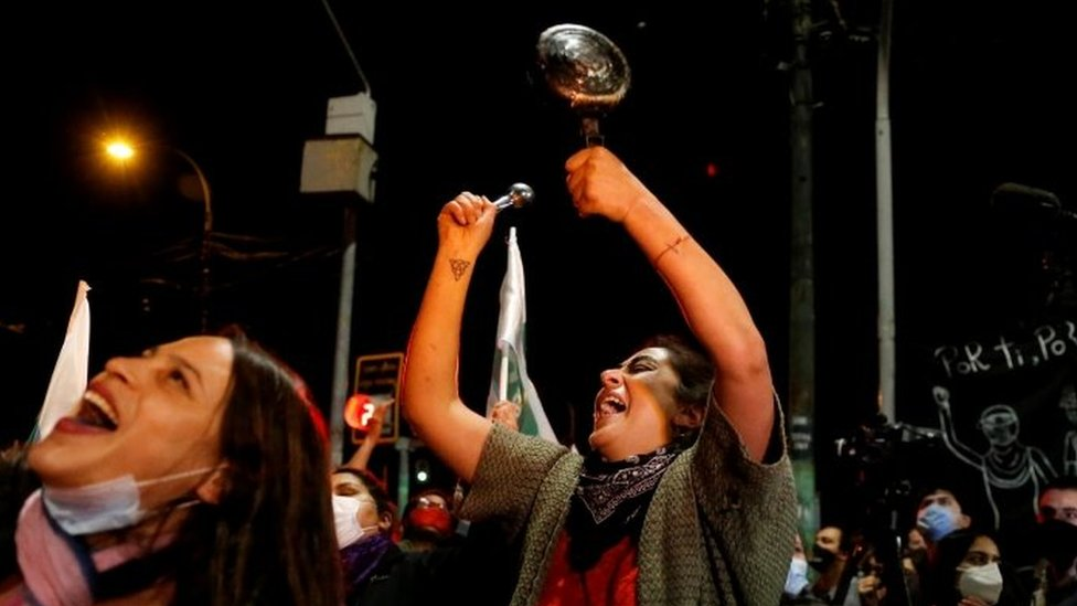 A woman bangs a pot as she reacts to the referendum on a new Chilean constitution in Valparaiso, Chile, October 25, 2020