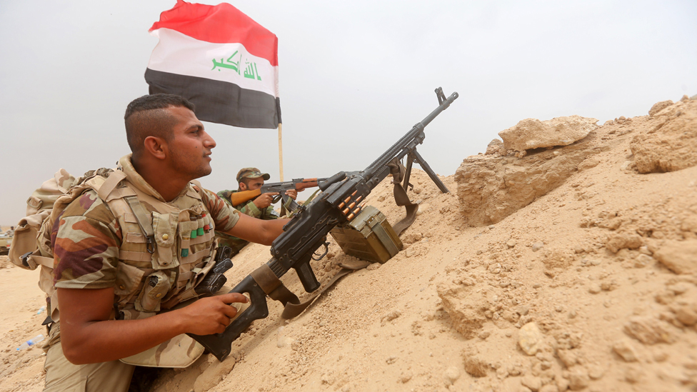 Shia fighters from the popular mobilisation units hold a position on the Tharthar frontline on the edge of Anbar province, 120km north-west of Baghdad, on June 1, 2015.