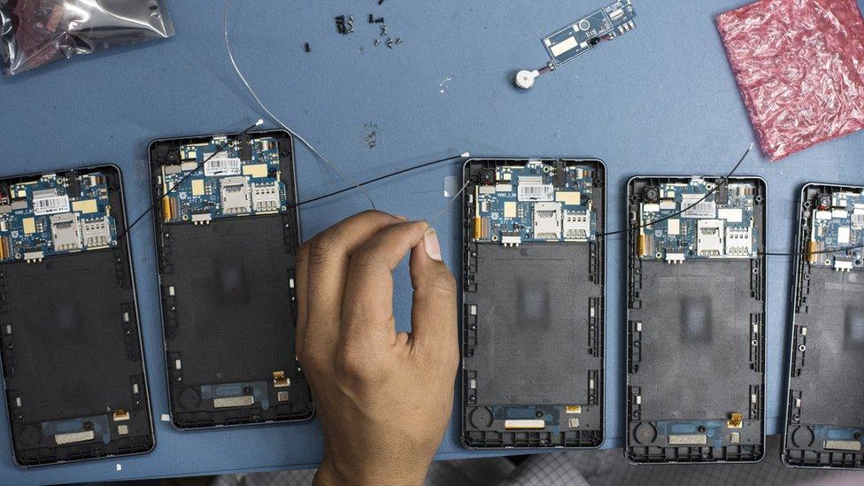 Technicians assemble smartphones