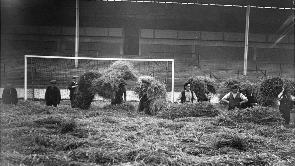 2nd December 1925: Groundstaff lay 3,000 bales of straw at Tottenham Hotspur's football pitch (White Hart Lane) to protect the ground from frost.