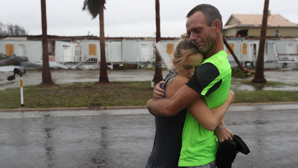 Jessica Campbell hugs Jonathan Fitzgerald (L-R) after riding out Hurricane Harvey in an apartment on August 26, 2017 in Rockport, Texas