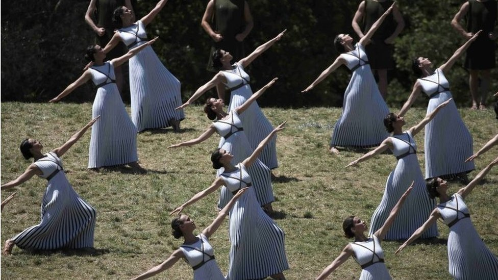 Priestesses and dancers attend the Olympic flame lighting ceremony for the Rio 2016 Olympic Games inside the ancient Olympic Stadium on the site of ancient Olympia (21 April 2016)