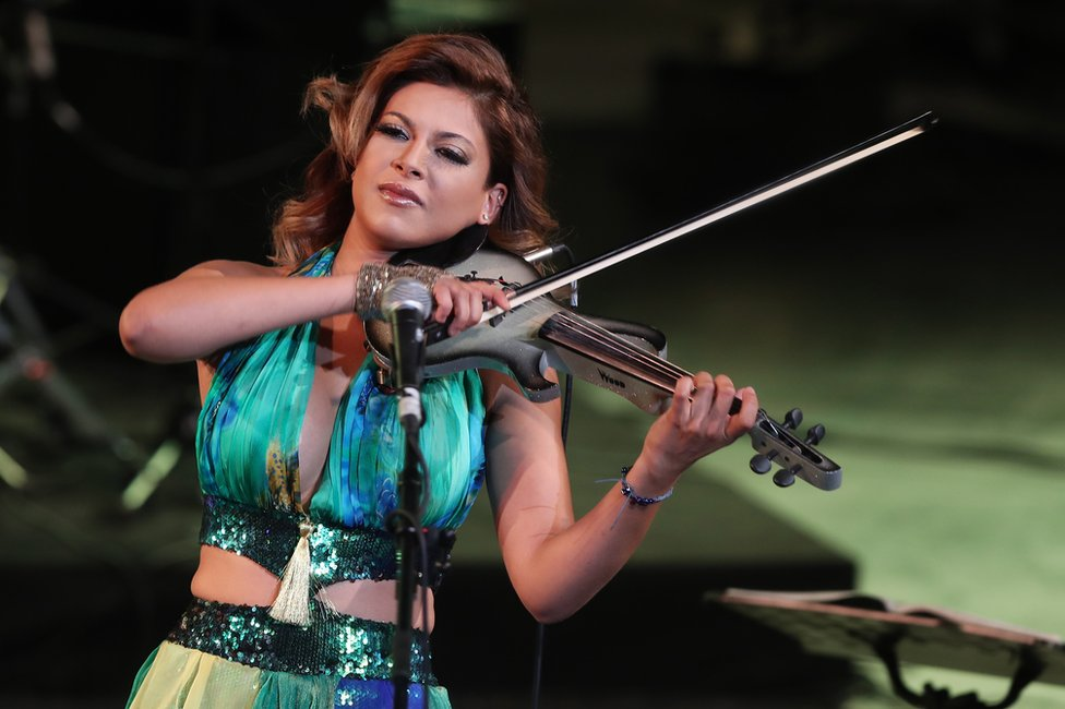 Tunisian singer and violinist Yasmine Azaiez performs on stage.