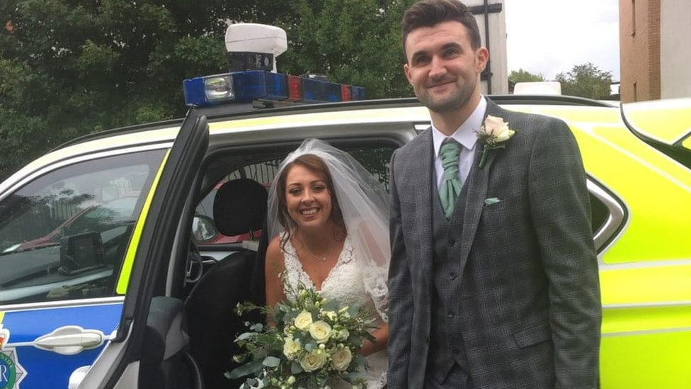 Armed police officers save newlyweds from rain