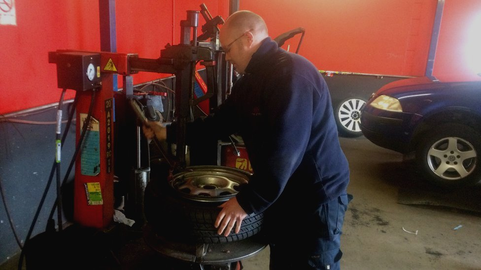 Kevin McCool of KMC Tyres in Londonderry checking a car tyre