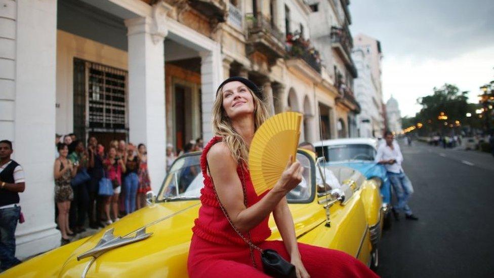 Brazilian model Gisele Bundchen poses before the show in Havana