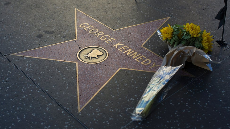 Flowers on George Kennedy's star on the Hollywood Walk of Fame