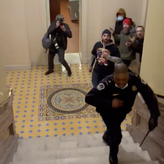 Officer Goodman is chased up a set of stairs by a group of rioters