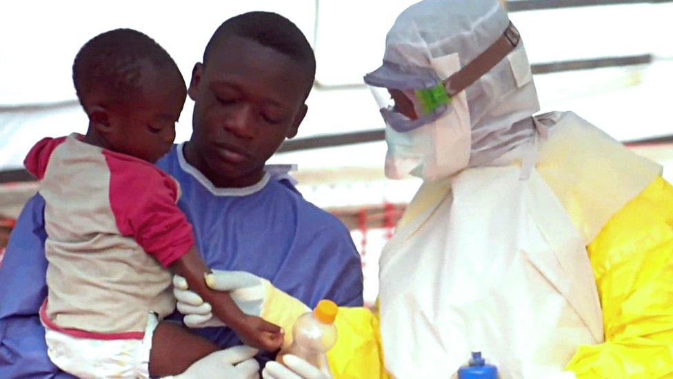 Child and health workers at Ebola centre