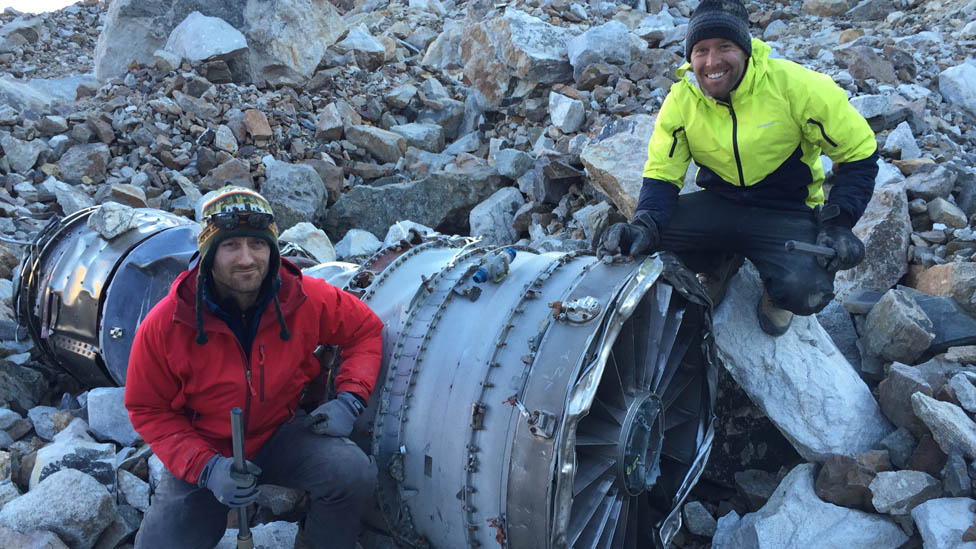 Futrell and Stoner with a plane engine part in Bolivia