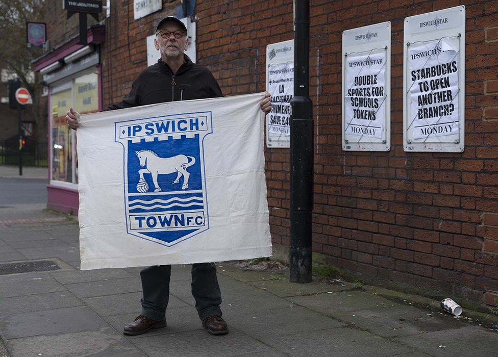 Andrew Kerrison with his home-made banner