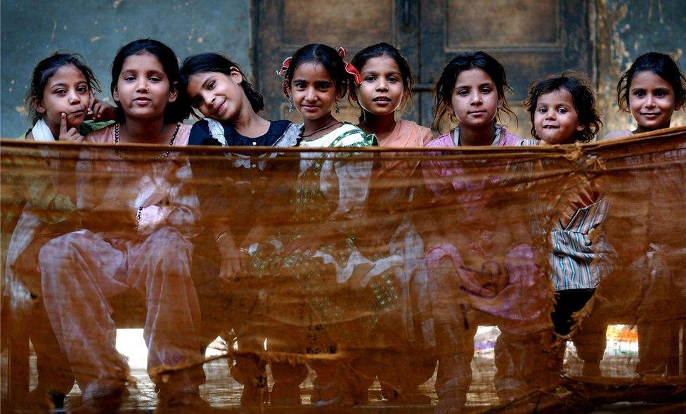 Children inside Dariya Khan Ghhumnat Rahat refugee camp set up outside a school in the state of Gujarat in Ahmedabad, India, 2002