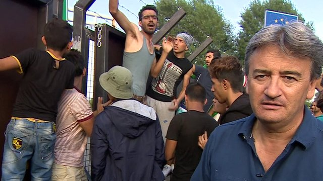 BBC reporter Fergal Keane reporting from in front of the Serbian-Hungarian border in Horgos