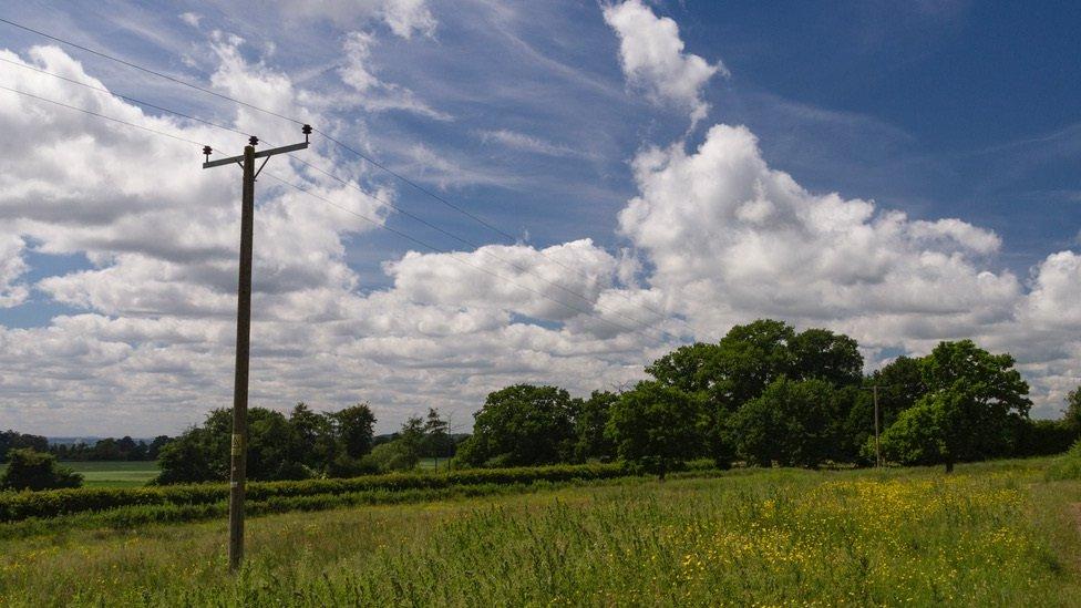 A telegraph pole in a rural area