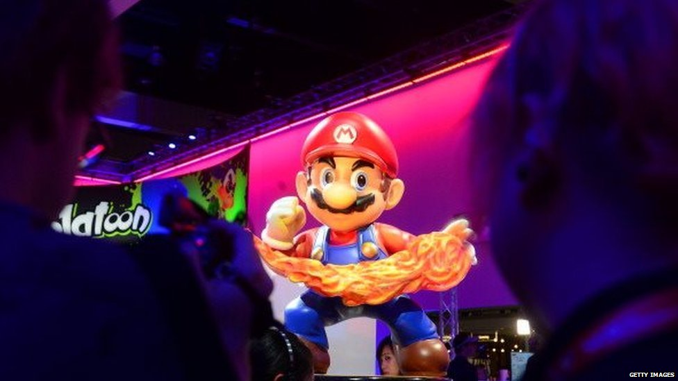 A Super Mario display at the Nintendo section attracts attention at the annual E3 video game extravaganza in Los Angeles, California on June 10, 2014