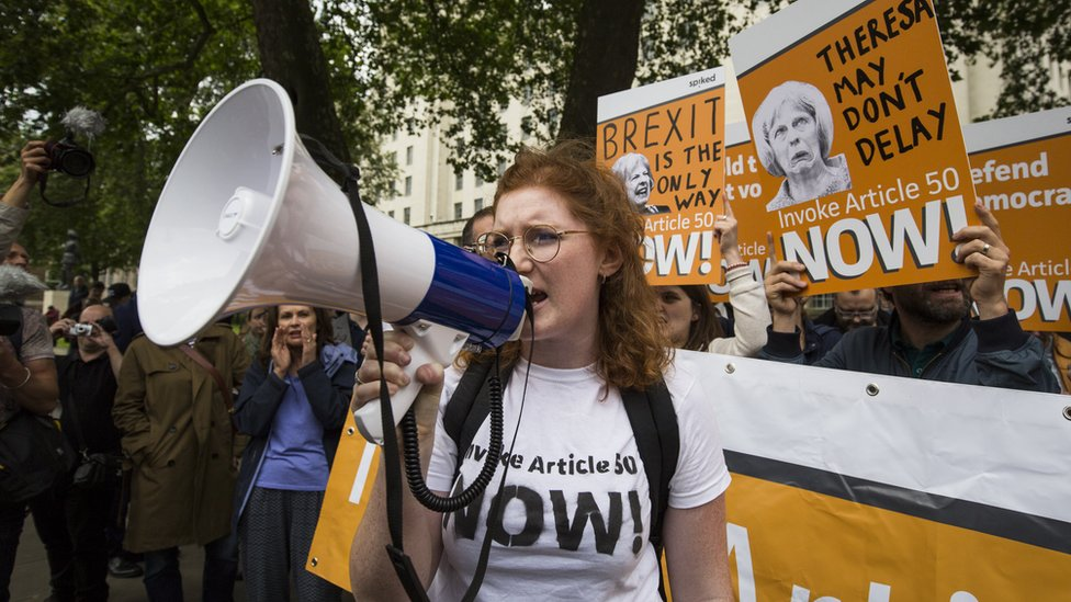 A pro-Brexit demonstrator chants during a protest outside Downing Street