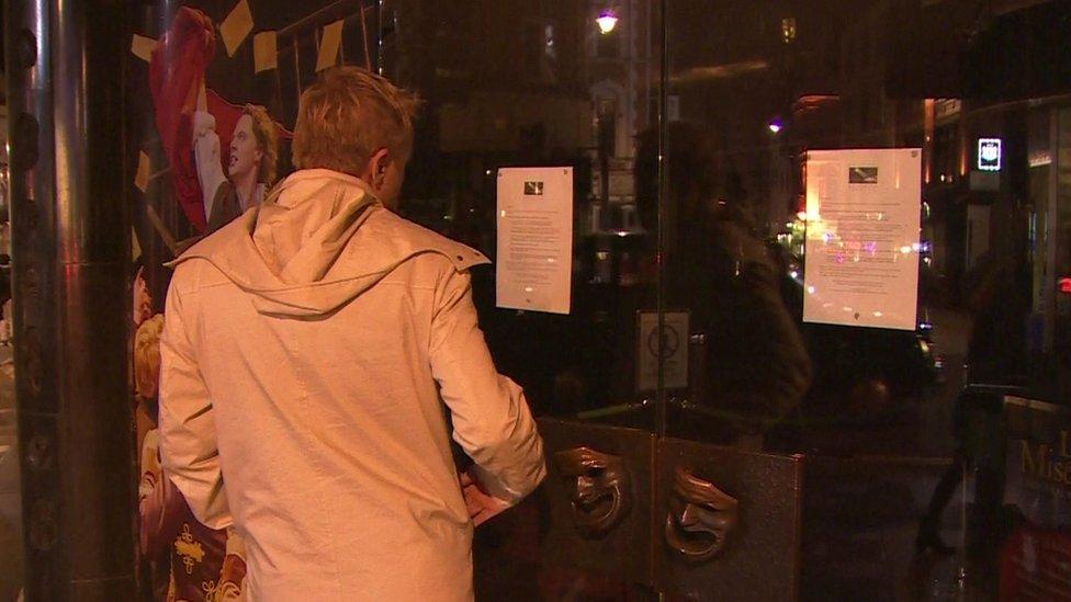 Signs on doors of theatre