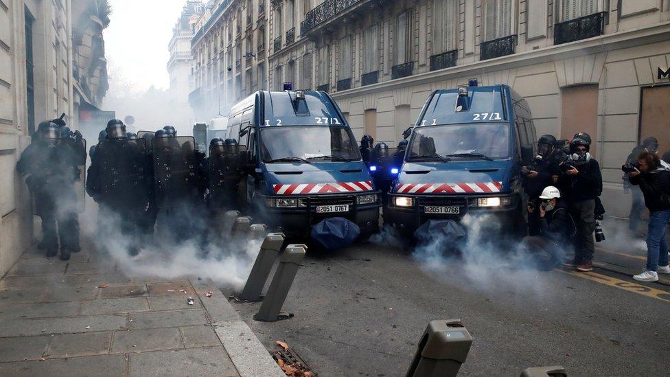 Police cordon and tear gas