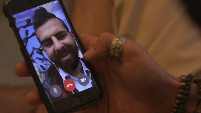 Joseph, a gay Syrian, is on the phone with his boyfriend in Istanbul