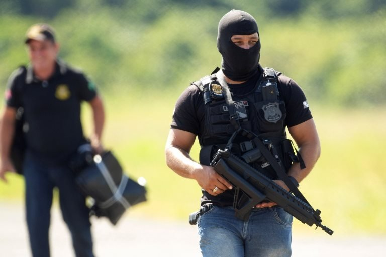 A penitentiary agent guards the arrival of forensic experts at the Altamira Regional Recovery Center, in Altamira, Brazil, 30 July 2019.