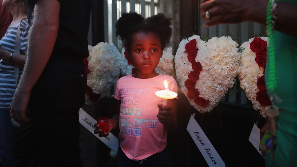 Six-year-old Mariah attends a memorial service with her mother Kristie Holt in the Oregon District to recognize the victims of an early-morning mass shooting in the popular nightspot on August 04, 2019 in Dayton, Ohio