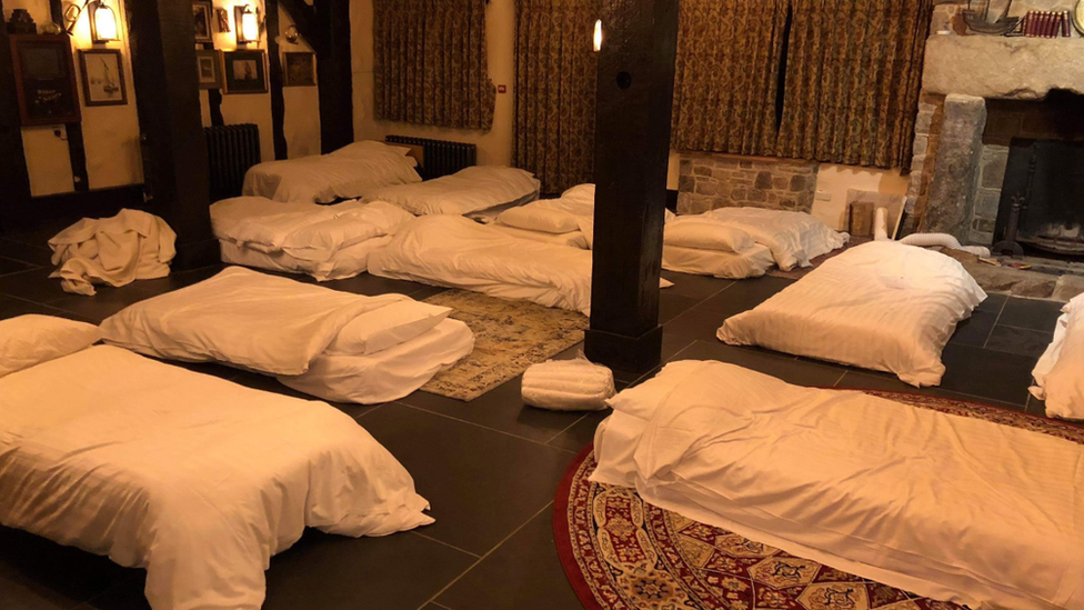 beds on the floor of a pub