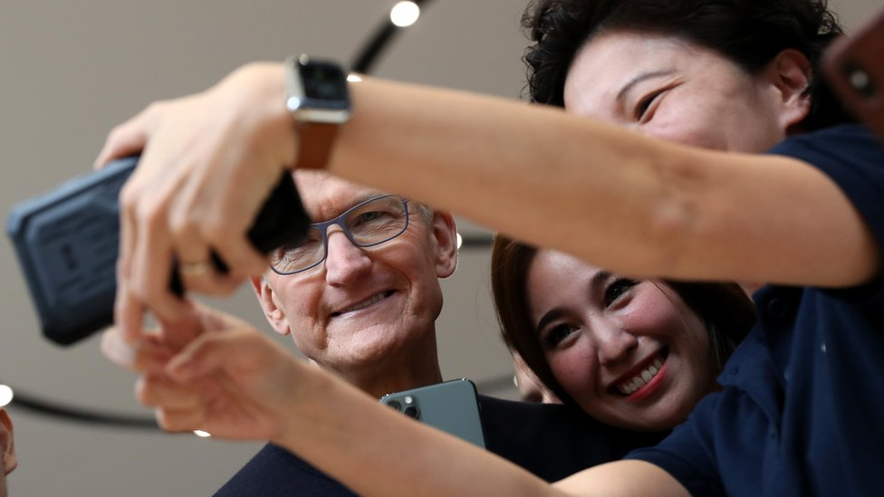 Apple CEO Tim Cook takes a selfie with attendees during an Apple special event on September 10, 2019 in Cupertino, Califo