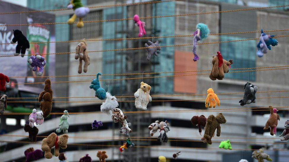 View of stuffed animal toys hanged from ropes in remembrance of murdered women, in the framework of the International Day for the Elimination of Violence against Women, in Tegucigalpa, on 25 November, 2019.