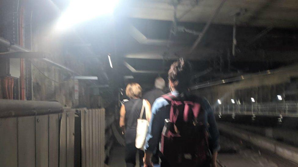Passengers leaving the train via an emergency tunnel