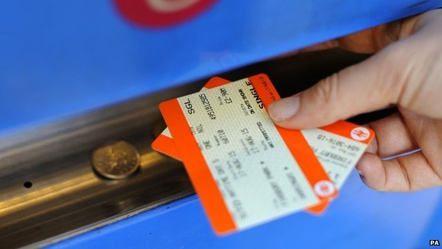 Person buying a train ticket