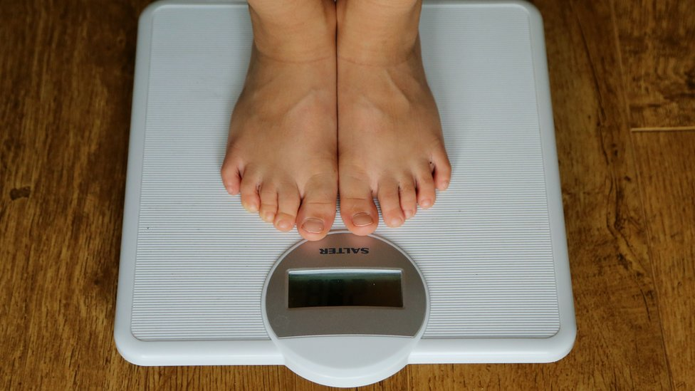 A child being weighed on scales