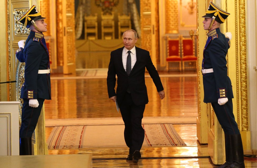 Russian President Vladimir Putin enters the hall during the reception marking the Day of Heroes of the Fatherland at Grand Kremlin Palace in Moscow, 11 December 2019