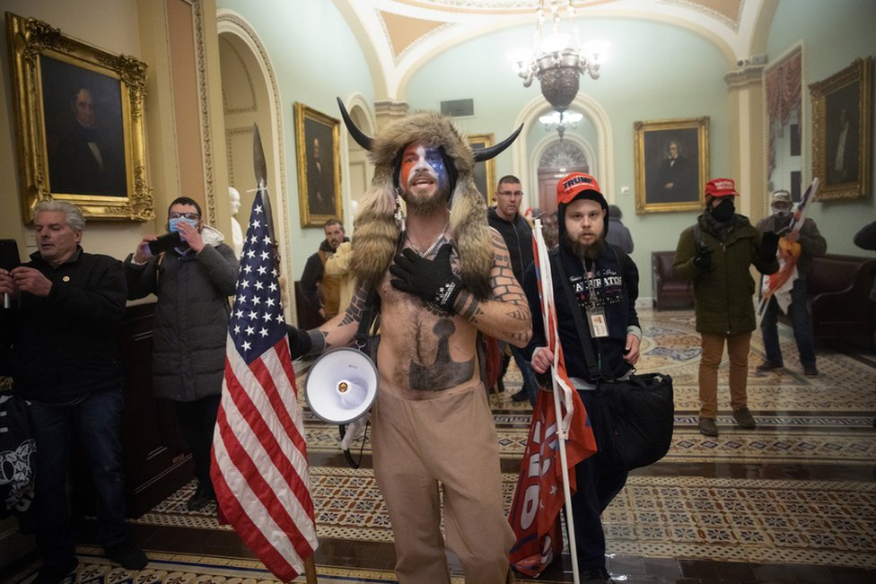 A pro-Trump mob confronts US Capitol police outside the Senate chamber on 6 January 2021 in Washington, DC.