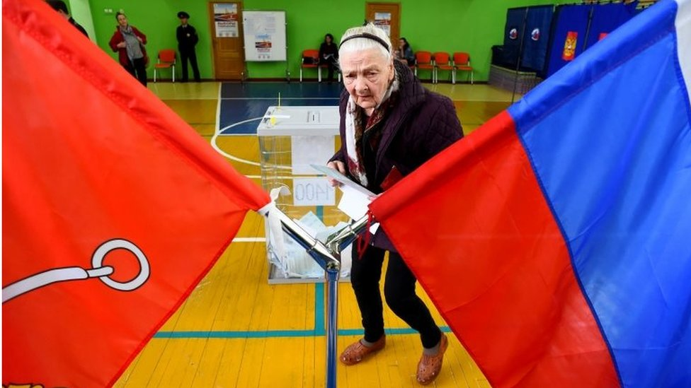 A woman votes in St Petersburg, Russia. Photo: 8 September 2019