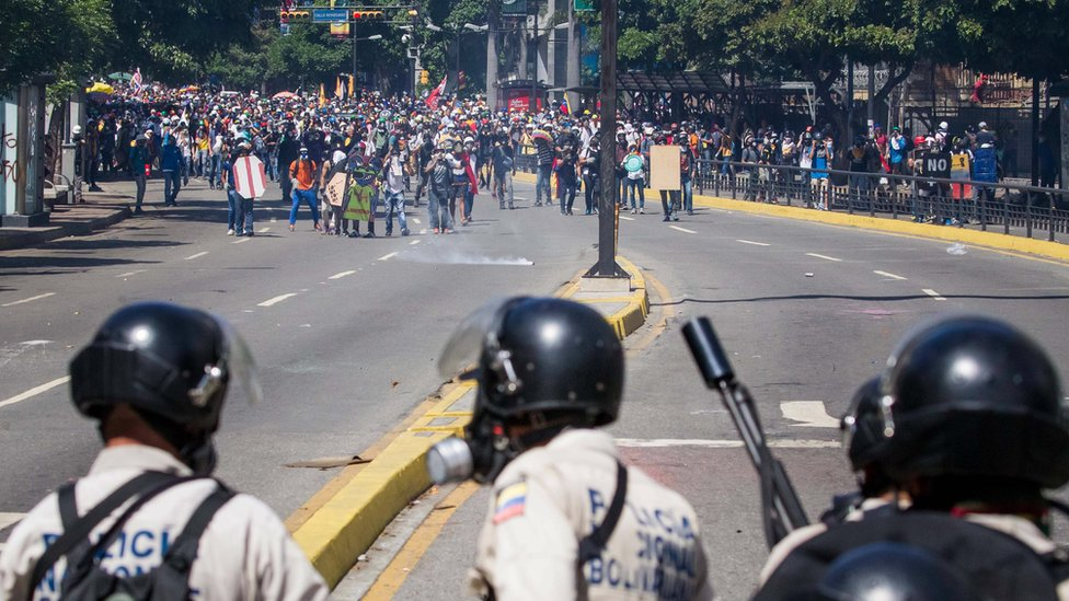 Protesters clash with police during an opposition protest in Caracas, Venezuela, 30 May 2017