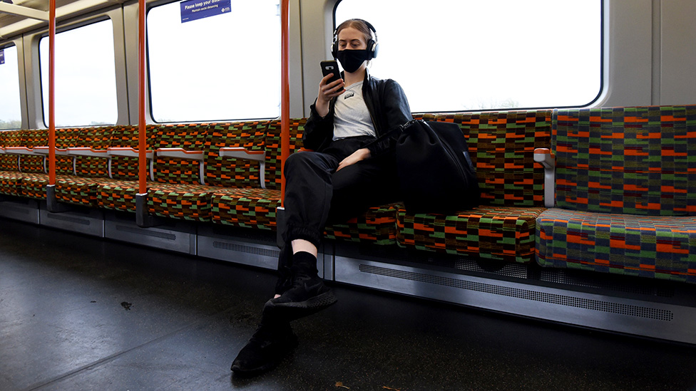 A passenger on the tube in central London - 29 October 2020