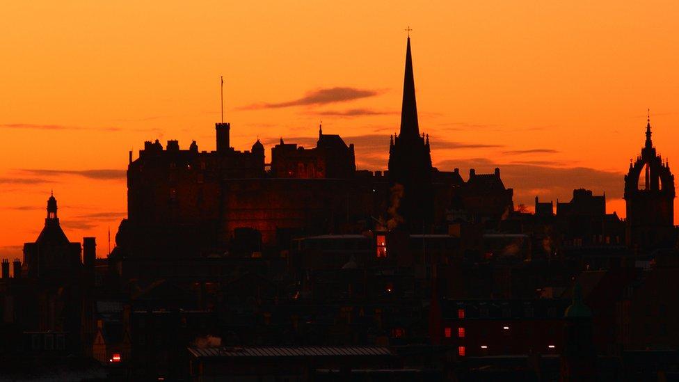 The skyline of Edinburgh against an evening sky