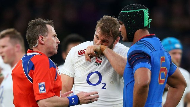 Nigel Owens in discussion with England captain Chris Robshaw and France's Thierry Dusautoir