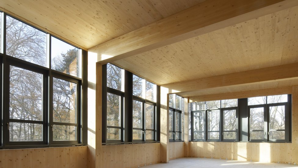 Wooden house interior with large windows