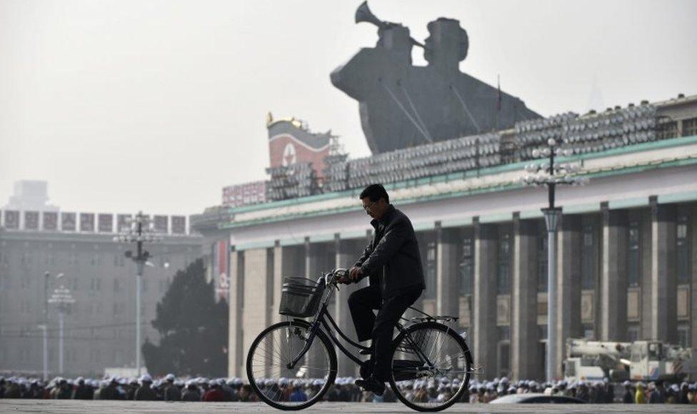 A man rides a bike through Kim Il-sung square in Pyongyang, North Korea (file image)