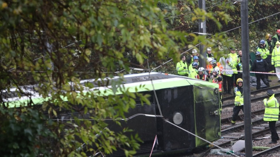 Firefighters are working to free two people who remain trapped in the tram