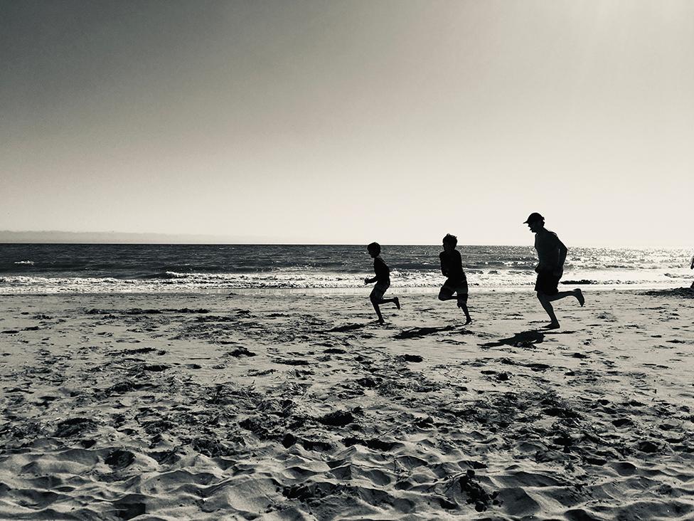 People running on at Hidden Beach in California.