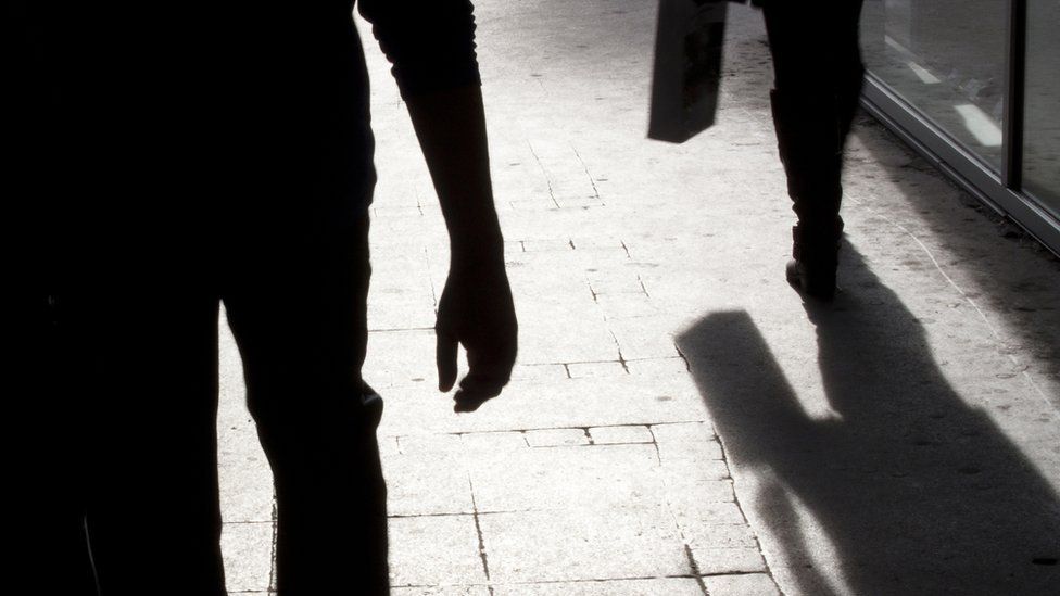 Silhouette of man following a man