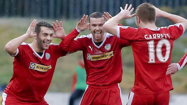 Cliftonville's David McDaid, Martin Donnelly and Stephen Garrett celebrate scoring against Ballymena