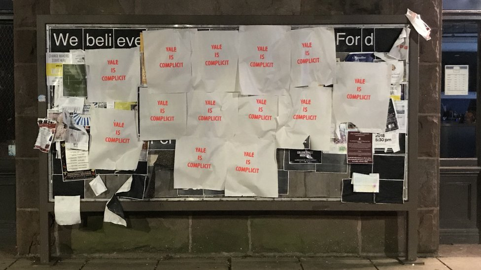 "Photo of posters saying ""Yale is complicit"" at Yale"